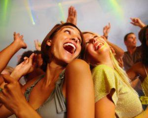 Boulder Eye Care & Surgery Center Doctors two women dancing and laughing 300x239 - two-women-dancing-and-laughing